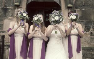 Bride and bridesmaids hold up their bouiquets.jpg