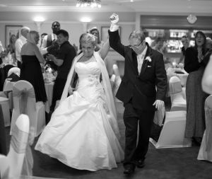 bride and groom cheered into reception.jpg