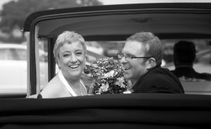 bride and groom in the back of convertable rolls royce.jpg