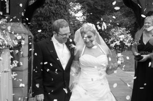 bride and groom under the confetti.jpg